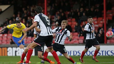 Louie Theophanous scores against Grimsby Town in last season's FA Cup first round proper clash. Phot