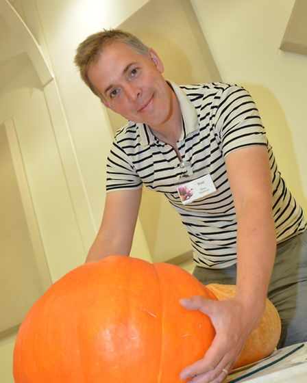 St Ives Flower, Produce and CraftShow, at the Corn Exchange, Organiser Matthew Hall with a pumpkin,