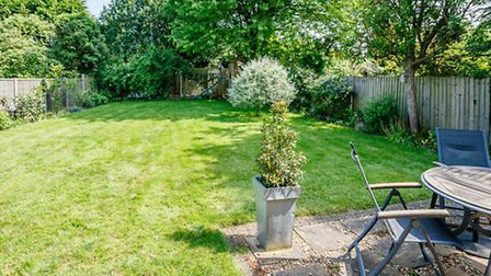 The east-facing rear garden is mainly laid to lawn
