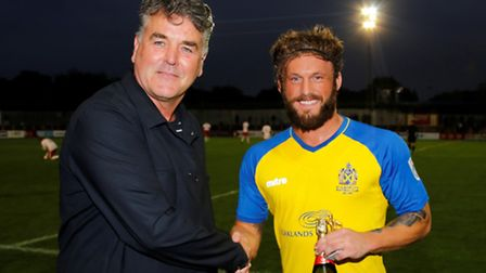 Scott Thomas picks up his prize as August's player of the month. Picture: LEIGH PAGE