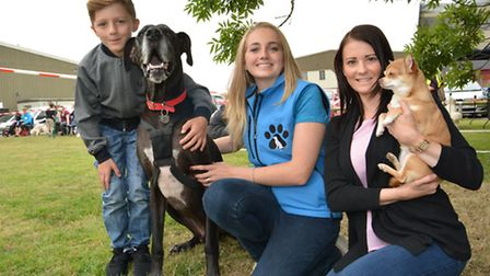 (l-r) Paisley with Hercules, Lizzie Rogers from Canine Central, and Lucy Paul with Lily,