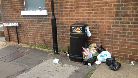 Litter bin in Hedley Road in St Albans piled with rubbish