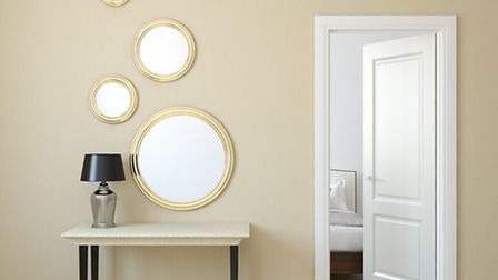 Hallways can benefit from a mirror or four