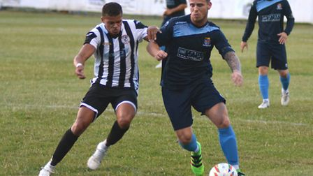 Andrew Phillips (left) saw St Ives Town's best chance saved in their goalless draw against Merthyr.