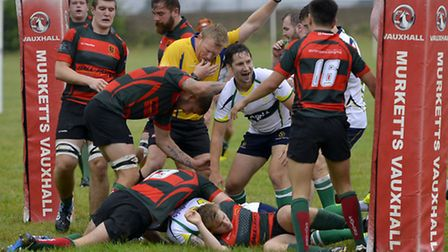 Ben Strangeways leads the celebrations after Tango Morgan goes over for a try during Huntingdon's vi