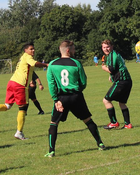 Athletico Quat's Darren Cavaree heads home his side's second goal against New Greens