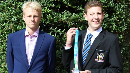 Ralph Muncer shows off his silver medal from the ASA National Finals alongside fellow St Columba's s