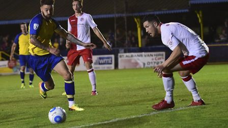 Louie Theophanous hunts for another goal against Poole Town. Picture: BOB WALKLEY