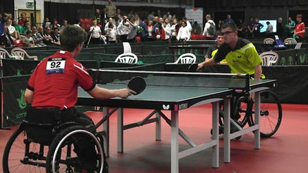 Daniel Bullen of St Neots (right) in action during the wheelchair table tennis final at the School G