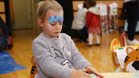 Amy Doherty, four, gets stuck in with the craft activity.