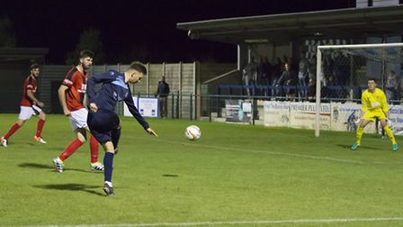 Ryan Hawkins hits St Neots' final goal against Kettering. Picture: CLAIRE HOWES