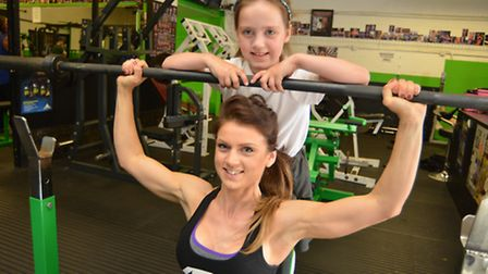 Bodybuilder Katie Sibley, with daughter Ellie, before the show.