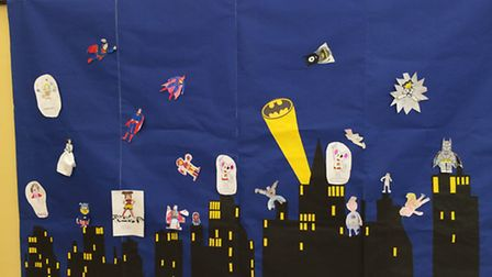 The scene was decorated with pictures drawn by all the superheroes at the tea party.
