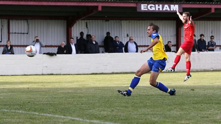 Sam Merson slots home to secure the Saints entry into the next round of the cup. Picture: LEIGH PAGE