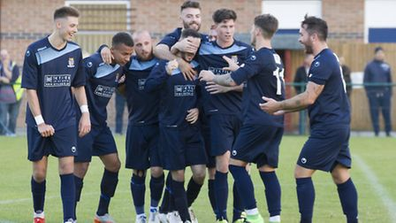 St Neots Town players celebrate Peter Clark's late clincher against Cinderford. Picture: CLAIRE HOWE