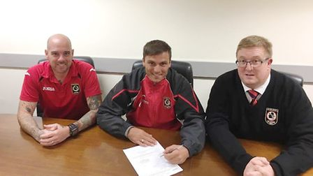 New Huntingdon Town signing Donatas Petrauskas with manager Bob Warby (left) and chairman Doug McIlw