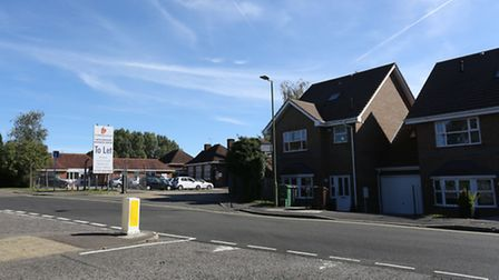 The entrance of Hertfordshire Business Centre with adjacent houses.