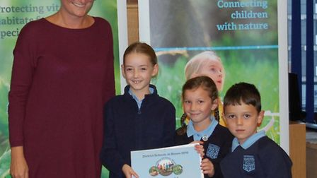 Emma Norrington of the Herts and Middx Wildlife Trust - one of the sponsors - with pupils from Skywo