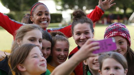 Scotland and Arsenal ladies Emma Mitchell takes a selfie with High Beeches School pupils as Alex Sco