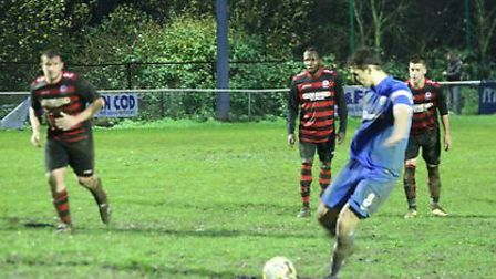 Greg Shaw scores from the penalty spot. Picture: JIM WHITTAMORE