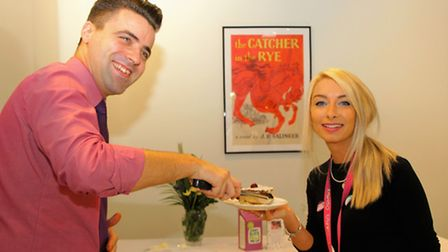 Hub manager Siegmar Parton, and Chloe Dobson, café manager, with some of the delicious cakes and pas