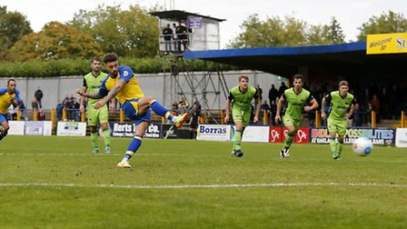 Louie Theophanous looks on to see his penalty saved