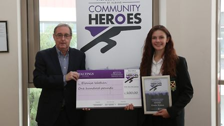 Maltings centre manager Phil Corrigan presents Elouise Wathen with her Community Heroes award.