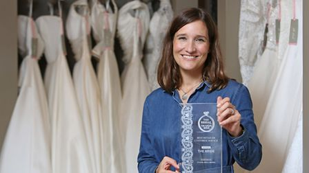 Owner of The Bride Polly Parkin with the award for Best Retailer Customer Service from The Bridal Bu