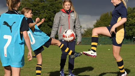 Arsenal ladies and England player Leah Williamson helps referee a game at St Albans Girls School.