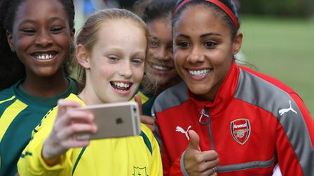 England and Arsenal ladies Alex Scott takes a selfie with pupils from St Nicholas School.