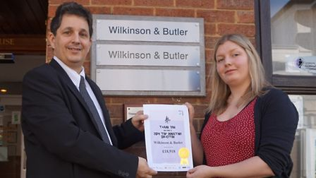 Louis Brandt of Wilkinson and Butler recently presented Wilkinson & Butler being presented with a ce