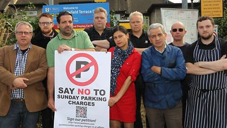 Local traders gather in the Keyfield Terrace car park to protest the introduction of Sunday parking