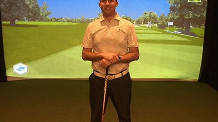 Verulam Golf Club professional Joel Saunders in front of the simulator of the Ryder Cup course at Ha