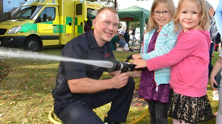 St Neots Fire Station Open Day, Fire Fighter Jason Manfield, with Stephanie and Naomi from St Neots,
