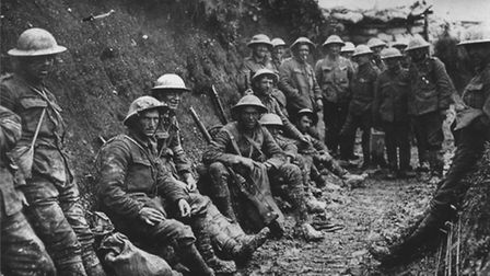 A ration party of the Royal Irish Rifles in a communication trench during the Battle of the Somme. T