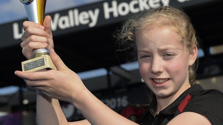 Scarlett Parkes of Beaumont School lifts the trophy at the Schools Hockey Festival. Picture: ADY KER