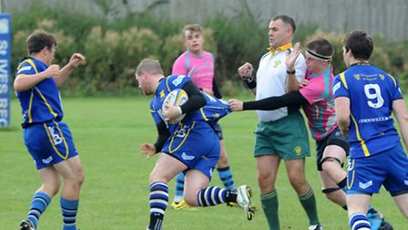 Paul Ashbridge (on the ball) kicked two penalties in St Ives' heavy defeat.