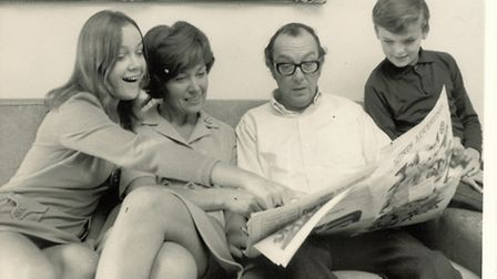 Eric Morecambe with Joan and two of their children reading the Herts Advertiser
