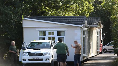 A mobile home blocks Coursers Road as it is maneuvered into Nuckies Farm.
