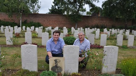 Thomas Campbell and dad Adrian at the grave of family member Alexander Robertson in Arras Memorial
