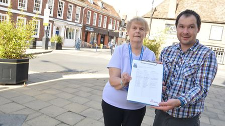Barbara Darling appealing for a crossing outside Saxongate, with Keith Green,