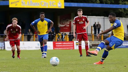 Shaun Lucien slots home from the penalty spot. Picture: LEIGH PAGE