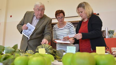 Alconbury & District Horticultural Show, (l-r) Judge Robin Hayden, with Stewards Jane Robinson, and