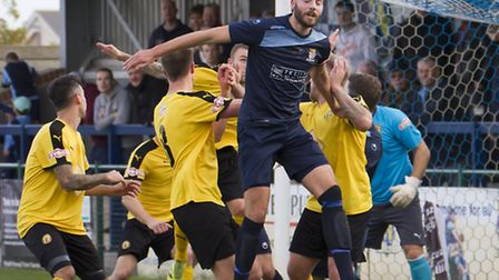 St Neots captain Tom Ward rises above a host of defenders during his side's defeat against Leamingto