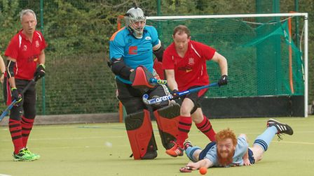 Mike Hornby at full stretch for St Neots 1sts in their East Men's League victory against Wisbech 2nd