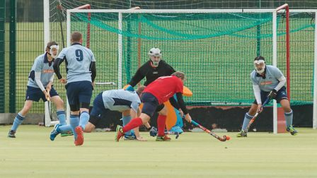 St Neots Men's 1sts have defending to do in their win against Wisbech 2nds. Picture: BARRY GIDDINGS