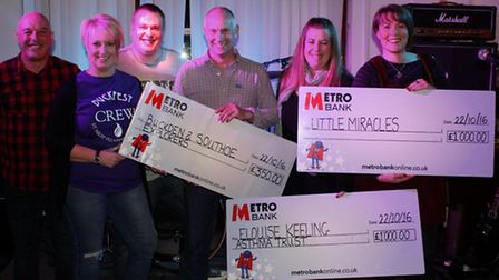 Buckfest committee hand over the cheques from this summer's event.