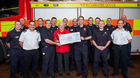 St Neots crew hand over cheque