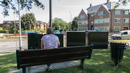 Four telecom boxes were installed in front of a bench at the edge of Priory Memorial Gardens in Augu