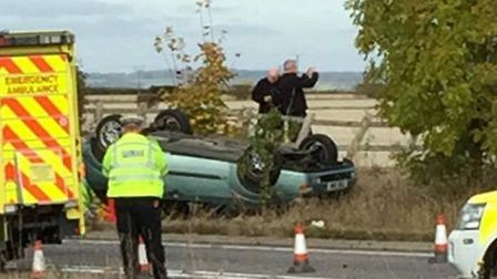 The car flipped onto its roof. Picture: Henry Jones